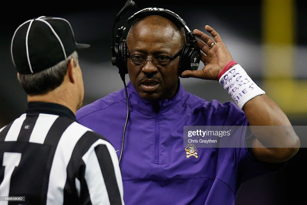 Head coach Ruffin McNeill of the East Carolina Pirates talks with an official during the game against the Louisiana-Lafayette Ragin Cajuns during the R+L Carriers New Orleans Bow at the Mercedes-Benz Superdome on December 22, 2012 in New Orleans, Louisiana.