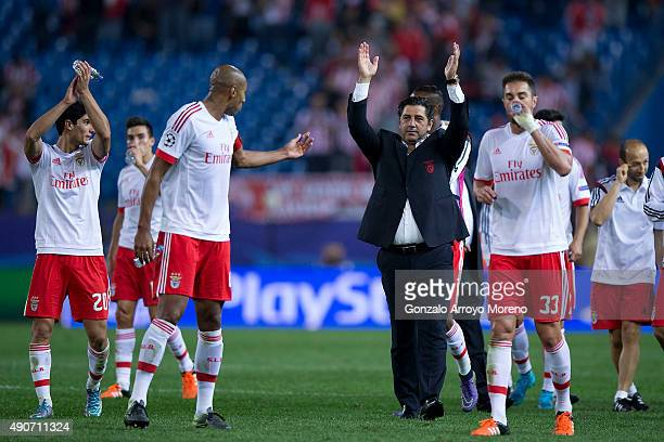 Head coach Rui Vitoria of SL Benfica greets their fans surrounded by his players after winning the the UEFA Champions League Group C match between...