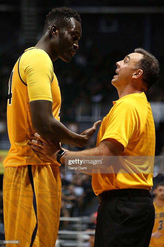 Head coach Russell Turner of the UC Irvine Anteaters talks to Mamadou Ndiaye #34 during the game against the Hawaii Rainbow Warriors at Stan Sheriff Center on February 12, 2016 in Honolulu, Hawaii.