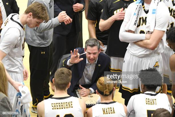 Head coach Ryan Odom of the UMBC Retrievers talks to his players during a time out of the Semifinal of the CollegeInsidercom Tournament against the...