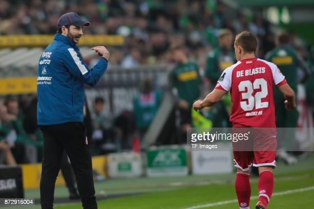 Head coach Sandro Schwarz of FSV Mainz 05 speaks with Vincenzo Grifo during the Bundesliga match between Borussia Moenchengladbach and 1 FSV Mainz 05...