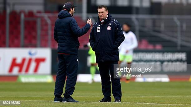 Head coach Sandro Schwarz of Mainz and head coach Uwe Koschinat of Fortuna Koeln talk prior to the Third League match between Fortuna Koeln an FSV...