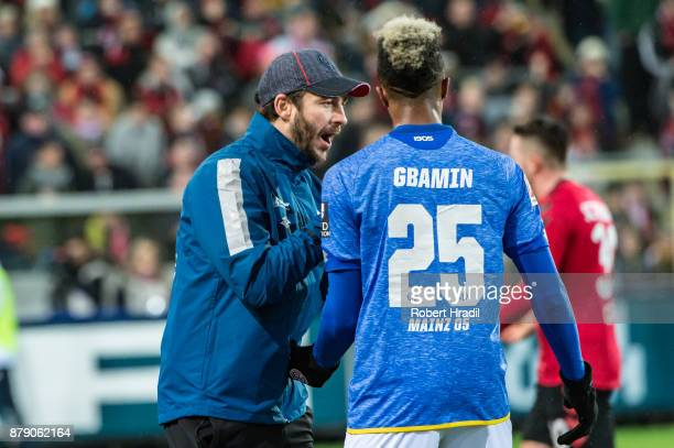 Head Coach Sandro Schwarz of Mainz gives instructions to JeanPhilippe Gbamin of Mainz during the Bundesliga match between SportClub Freiburg and 1...