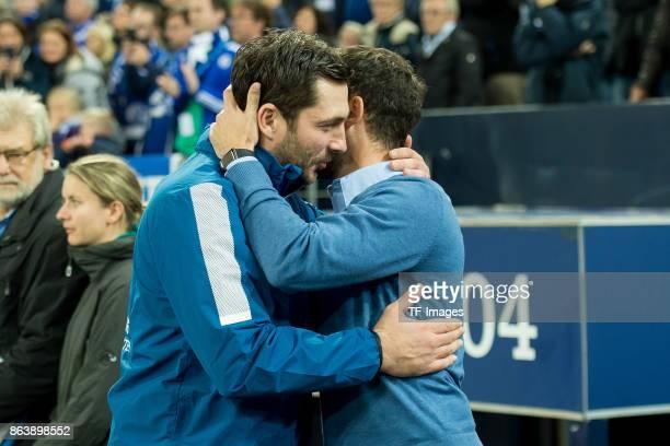 Head coach Sandro Schwarz of Mainz shakes hands with head coach Domenico Tedesco of Schalke during the Bundesliga match between FC Schalke 04 and 1...