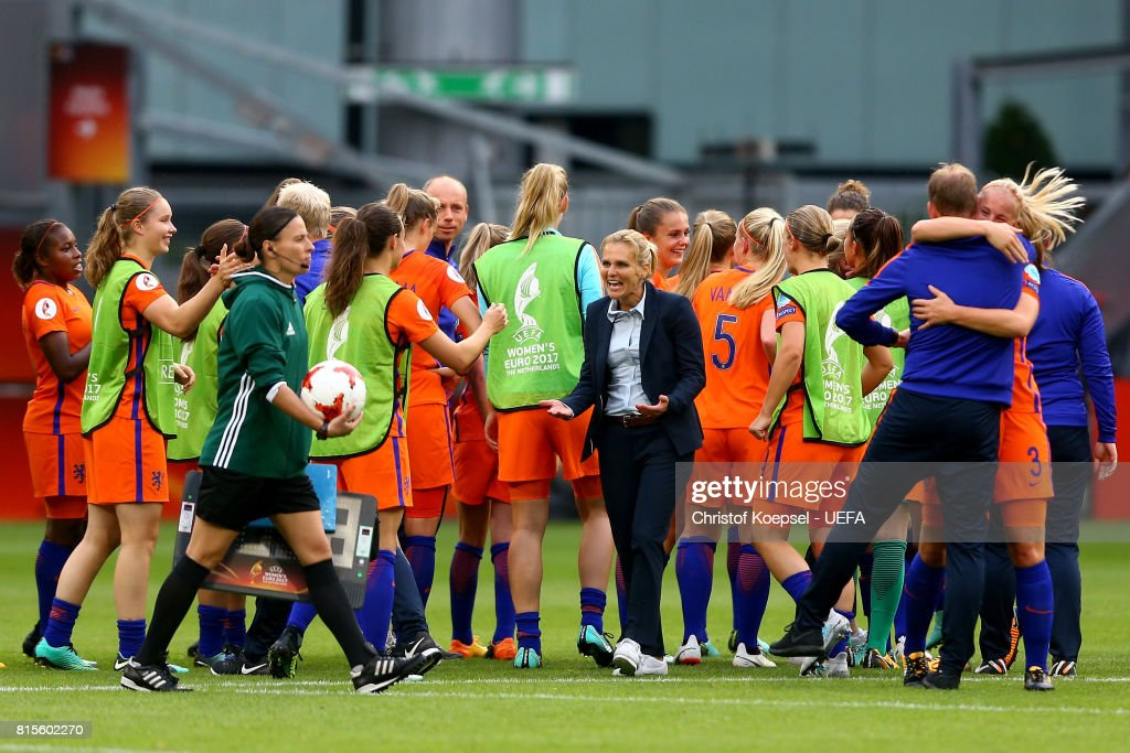 Head coach Sarina Wiegman of the Netherlands (C) celebrates with her tem after winning 1-0 the UEFA Women's Euro 2017 Group A match between Netherlands and Norway at Stadion Galgenwaard on July 16, 2017 in Utrecht, Netherlands.