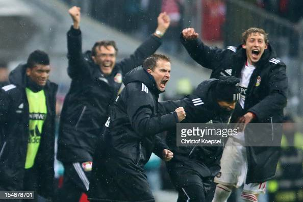 Head coach Sascha Lewandowski and Stefan Kiessling of Leverkusen celebrate the 21 victory after the Bundesliga match between FC Bayern Muenchen and...