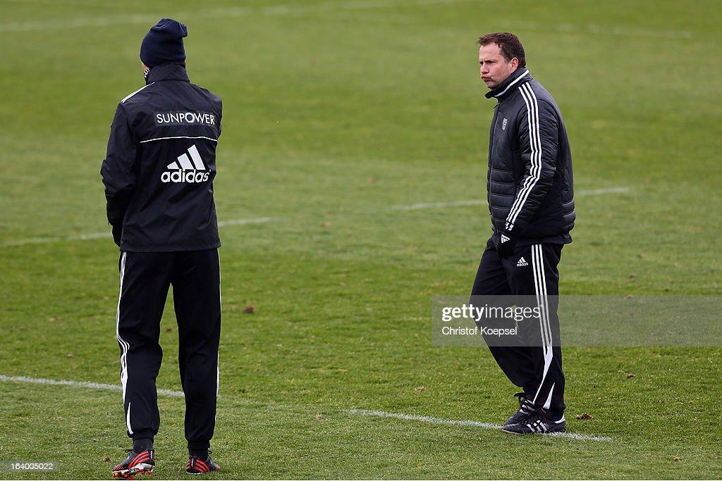 Head coach Sascha Lewandowski looks at team coach Sami Hyypiae during the Bayer 04 Leverkusen training session on March 19 2013 in Leverkusen Germany