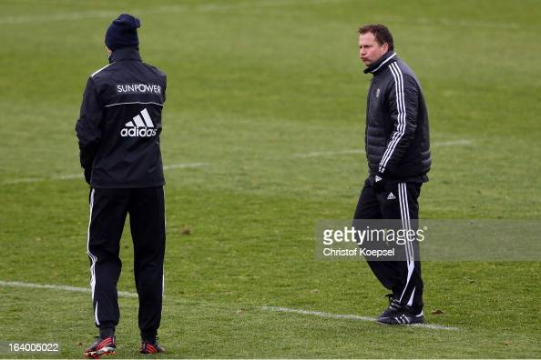Head coach Sascha Lewandowski looks at team coach Sami Hyypiae during the Bayer 04 Leverkusen training session on March 19 2013 in Leverkusen Germany