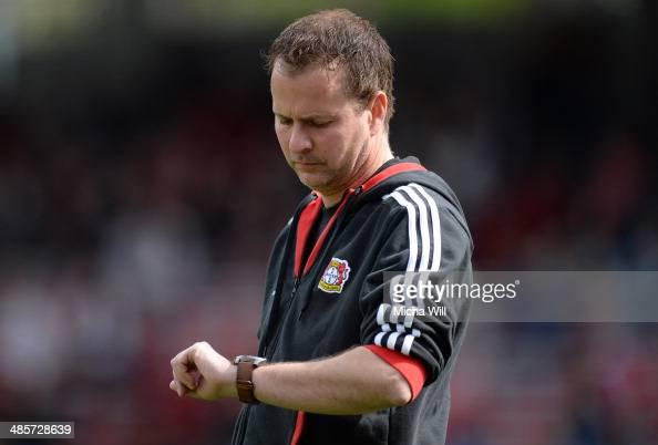 Head coach Sascha Lewandowski of Leverkusen checks his watch prior to the Bundesliga match between 1 FC Nuernberg and Bayer Leverkusen at Grundig...