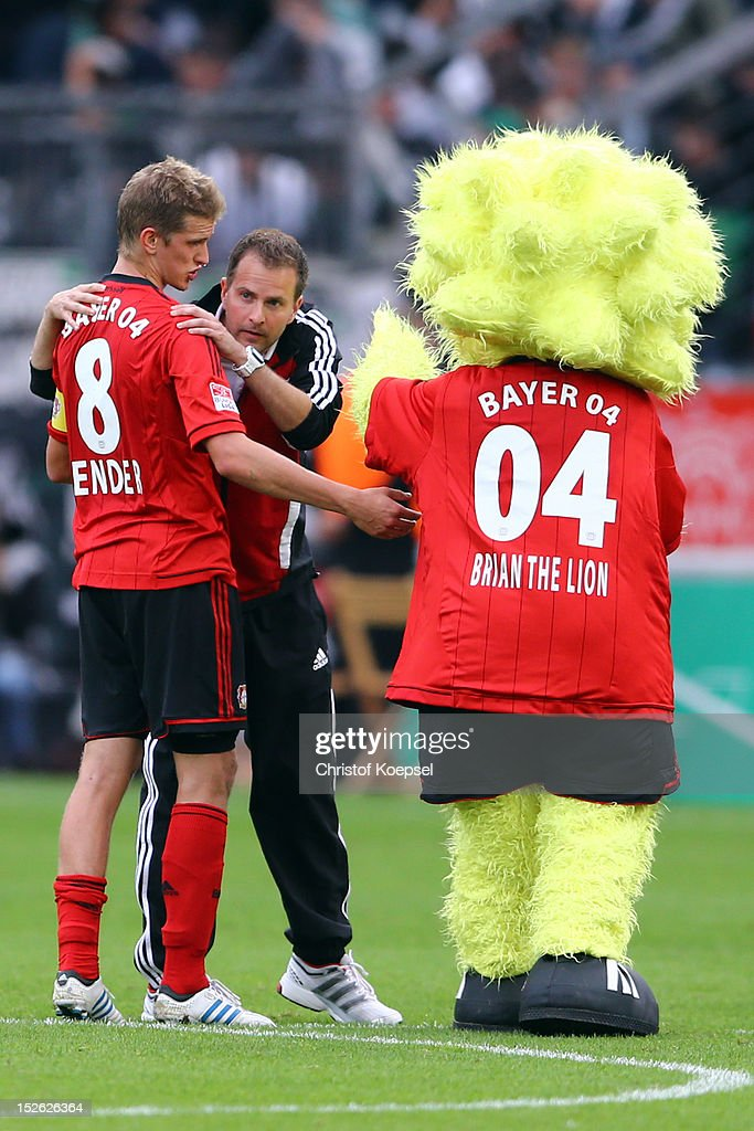 Head coach <a gi-track='captionPersonalityLinkClicked' href=/galleries/search?phrase=Sascha+Lewandowski&family=editorial&specificpeople=5134760 ng-click='$event.stopPropagation()'>Sascha Lewandowski</a> of Leverkusen (2nd L) comforts <a gi-track='captionPersonalityLinkClicked' href=/galleries/search?phrase=Lars+Bender&family=editorial&specificpeople=644948 ng-click='$event.stopPropagation()'>Lars Bender</a> of Leverkusen (L) after the 1-1 draw of the Bundesliga match between Bayer 04 Leverkusen and Borussia Moenchengladbach at BayArena on September 23, 2012 in Leverkusen, Germany.