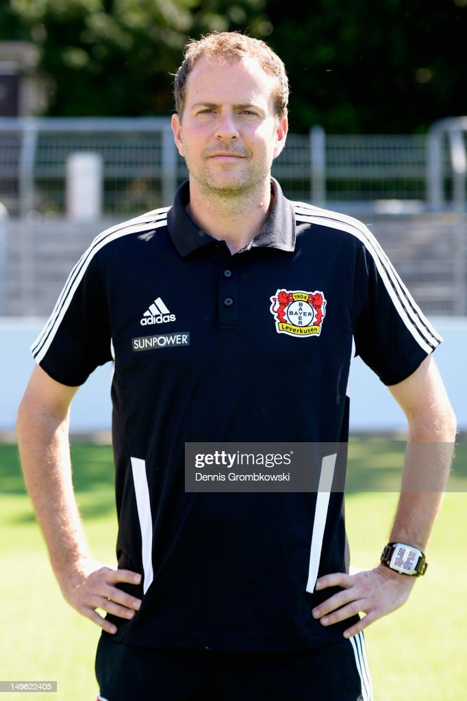 Head coach <a gi-track='captionPersonalityLinkClicked' href=/galleries/search?phrase=Sascha+Lewandowski&family=editorial&specificpeople=5134760 ng-click='$event.stopPropagation()'>Sascha Lewandowski</a> of Leverkusen poses during the Bayer Leverkusen team presentation on August 1, 2012 in Leverkusen, Germany.
