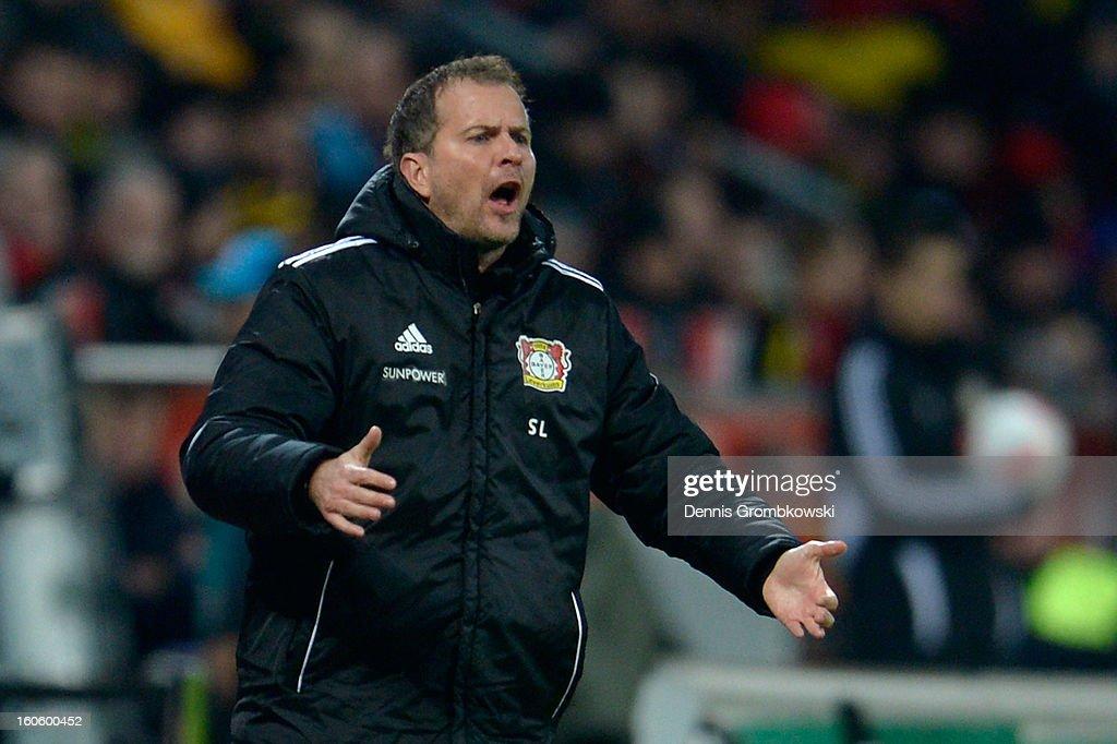 Head coach Sascha Lewandowski of Leverkusen reacts during the Bundesliga match between Bayer 04 Leverkusen and Borussia Dortmund at BayArena on February 3, 2013 in Leverkusen, Germany.