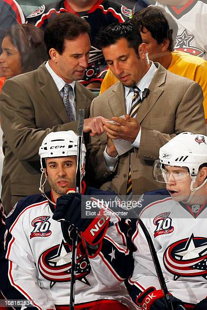 Head Coach Scott Arniel of the Columbus Blue Jackets chats with Assistant Coach Bob Boughner during a break in the action against Stephen Weiss of...