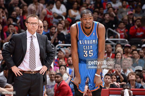 Head coach Scott Brooks of the Oklahoma City Thunder and Kevin Durant look on against the Los Angeles Clippers at Staples Center on April 9 2014 in...