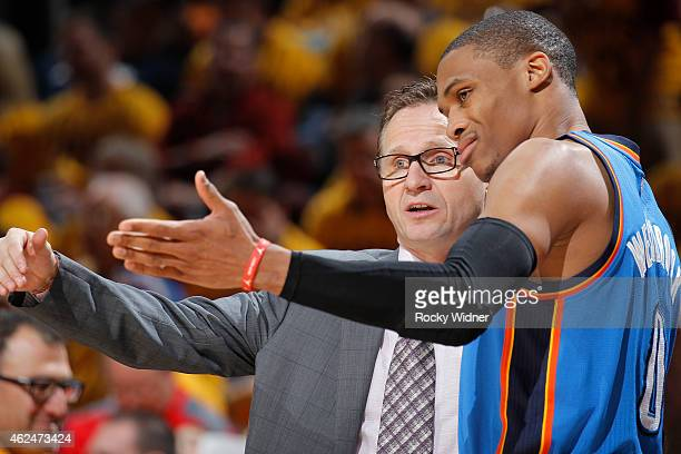 Head Coach Scott Brooks of the Oklahoma City Thunder coaches Russell Westbrook against the Cleveland Cavaliers on January 25 2015 at Quicken Loans...