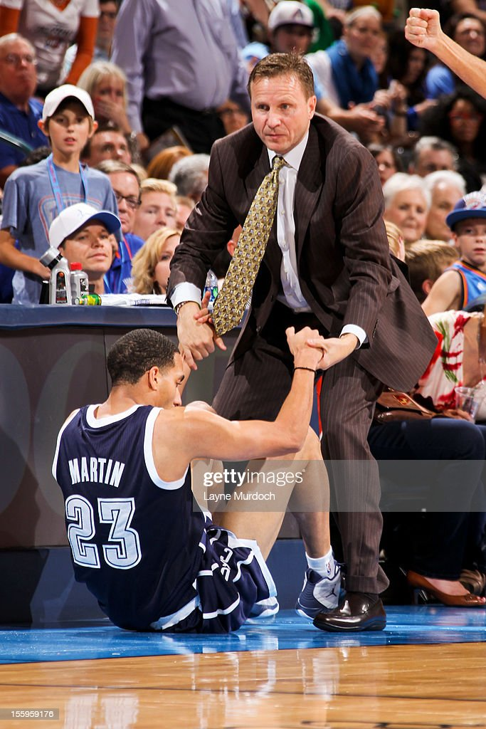 Head Coach <a gi-track='captionPersonalityLinkClicked' href=/galleries/search?phrase=Scott+Brooks&family=editorial&specificpeople=620053 ng-click='$event.stopPropagation()'>Scott Brooks</a> of the Oklahoma City Thunder helps up <a gi-track='captionPersonalityLinkClicked' href=/galleries/search?phrase=Kevin+Martin+-+Basketball+Player&family=editorial&specificpeople=204503 ng-click='$event.stopPropagation()'>Kevin Martin</a> #23 while playing against the Detroit Pistons on November 9, 2012 at the Chesapeake Energy Arena in Oklahoma City, Oklahoma.