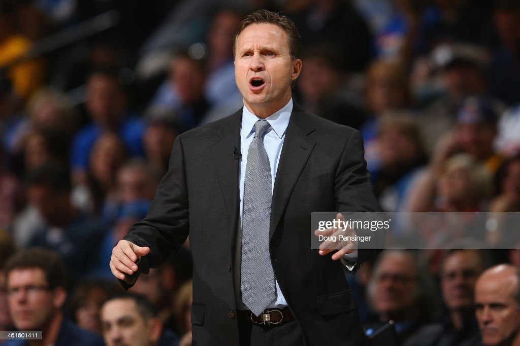 Head coach <a gi-track='captionPersonalityLinkClicked' href=/galleries/search?phrase=Scott+Brooks&family=editorial&specificpeople=620053 ng-click='$event.stopPropagation()'>Scott Brooks</a> of the Oklahoma City Thunder leads his team against the Denver Nuggets at Pepsi Center on January 9, 2014 in Denver, Colorado.