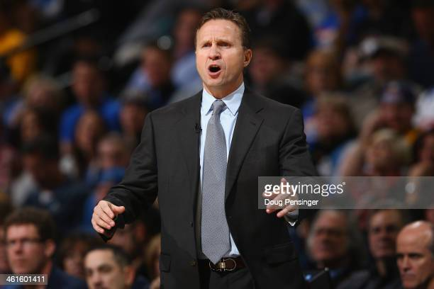Head coach Scott Brooks of the Oklahoma City Thunder leads his team against the Denver Nuggets at Pepsi Center on January 9 2014 in Denver Colorado...