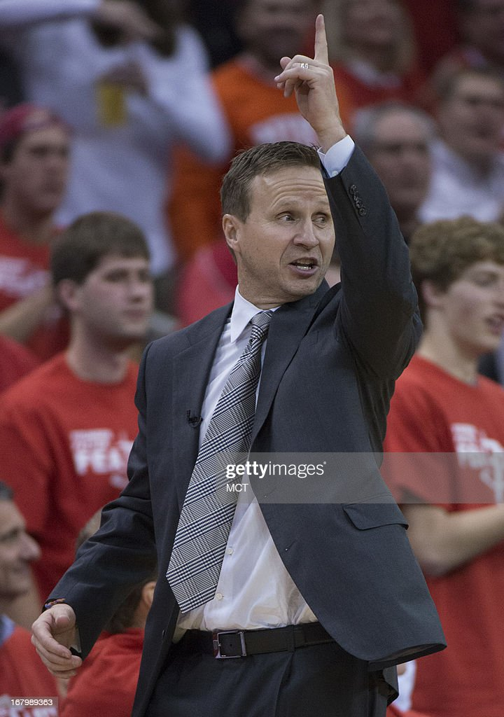 Head coach Scott Brooks of the Oklahoma City Thunder points to the scoreboard replay as he protests a call against his team facing the Houston Rockets in the second half of their Western Conference playoff game game on Friday, May 3, 2013, in Houston, Texas.