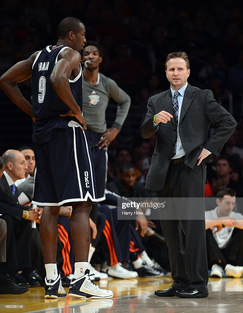 Head Coach Scott Brooks of the Oklahoma City Thunder reacts to play with Serge Ibaka #9 during a 106-95 loss to the Los Angeles Lakers at Staples Center on January 27, 2013 in Los Angeles, California.