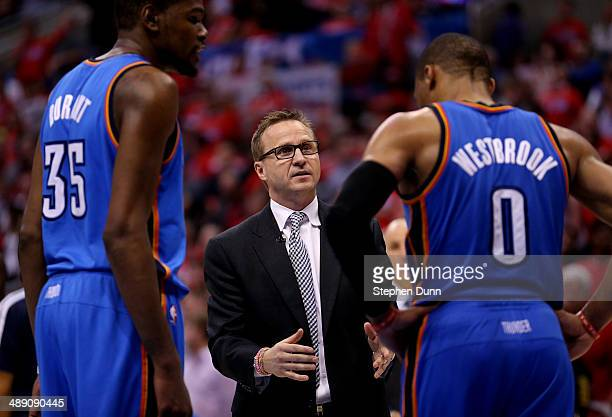 Head coach Scott Brooks of the Oklahoma City Thunder talks with Russell Westbrook and Kevin Durant against the Los Angeles Clippers in Game Three of...