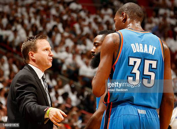 Head Coach Scott Brooks of the Oklahoma City Thunder talks with James Harden and Kevin Durant during Game Three of the 2012 NBA Finals against the...