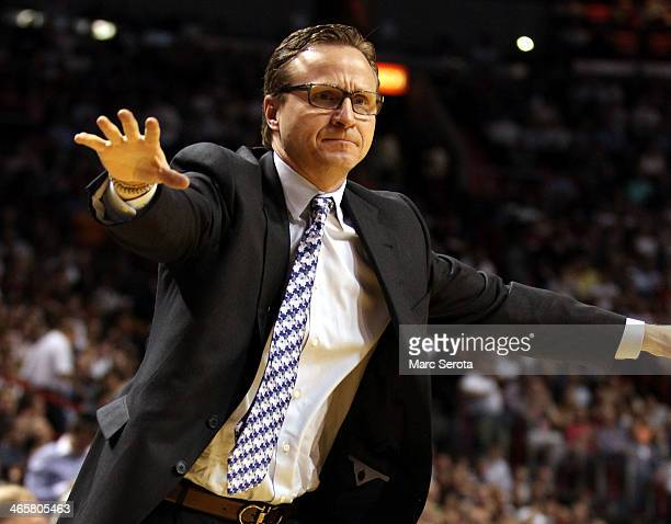 Head Coach Scott Brooks of the Oklahoma City Thunder watches his team against the Miami Heat at AmericanAirlines Arena on January 29 2014 in Miami...