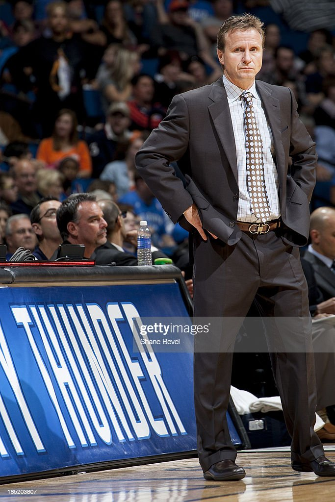 Head coach <a gi-track='captionPersonalityLinkClicked' href=/galleries/search?phrase=Scott+Brooks&family=editorial&specificpeople=620053 ng-click='$event.stopPropagation()'>Scott Brooks</a> of the Oklahoma City Thunder watches the action during the NBA preseason game against the New Orleans Pelicans on October 17, 2013 at the BOK Center in Tulsa, Oklahoma.