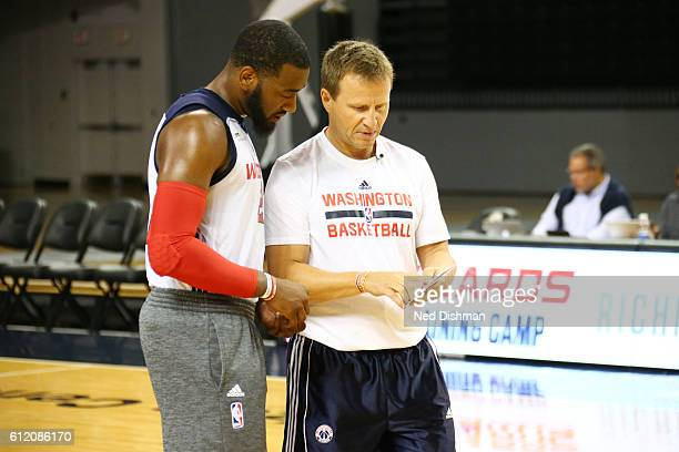 Head coach Scott Brooks of the Washington Wizards and John Wall of the Washington Wizards talk during a 2016 Training Camp open practice for fans at...
