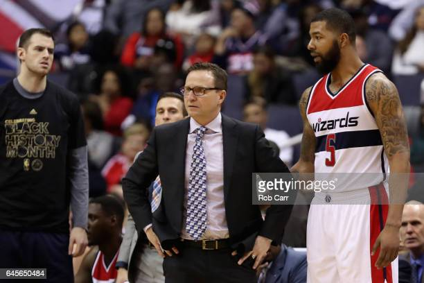 Head coach Scott Brooks talks with Markieff Morris of the Washington Wizards after Morris was ejected in the second half against the Utah Jazz at...