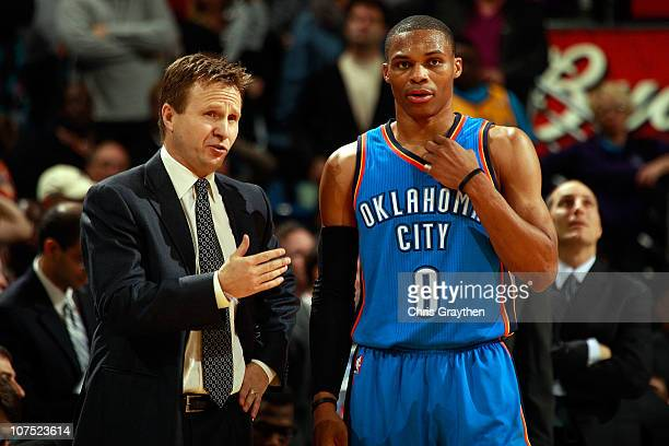 Head coach Scott Brooks talks with Russell Westbrook of the Oklahoma City Thunder during the game against the New Orleans Hornets at New Orleans...