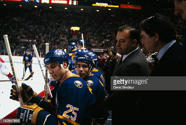 Head Coach Scotty Bowman of the Buffalo Sabres talks to Dave Andreychuk of the Buffalo Sabres on the bench at the Montreal Forum in Montreal Quebec...