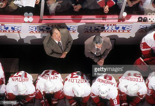 Head coach Scotty Bowman of the Detroit Red Wings stands behind the bench during an NHL game in January 1996 at the Joe Louis Arena in Detroit...