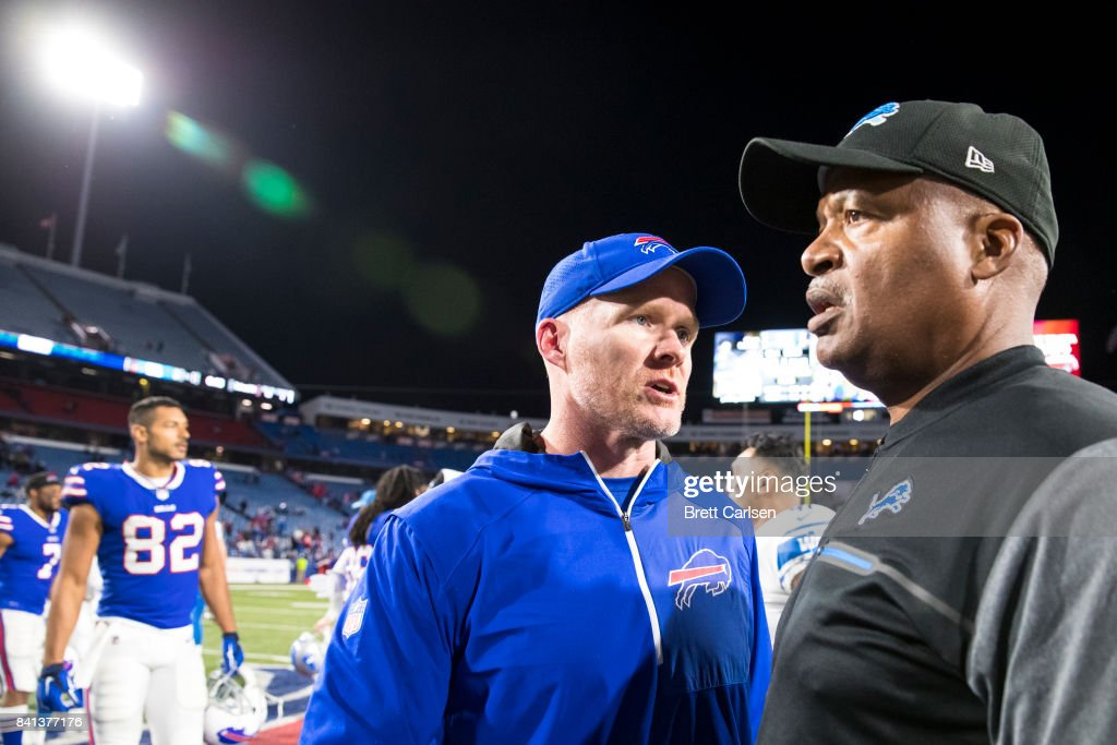 Head coach Sean McDermott of the Buffalo Bills shakes hands with head coach Jim Caldwell of the Detroit Lions after the preseason game on August 31, 2017 at New Era Field in Orchard Park, New York. Buffalo wins the preseason matchup over Detroit 27-17.