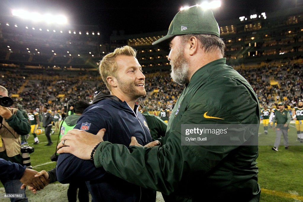 Head coach Sean McVay of the Los Angeles Rams and head coach Mike McCarthy of the Green Bay Packers meet after a preseason game at Lambeau Field on August 31, 2017 in Green Bay, Wisconsin.