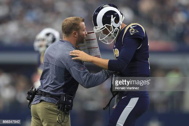 Head coach Sean McVay of the Los Angeles Rams talks with Jared Goff in the first half of a game against the Dallas Cowboys at ATT Stadium on October...