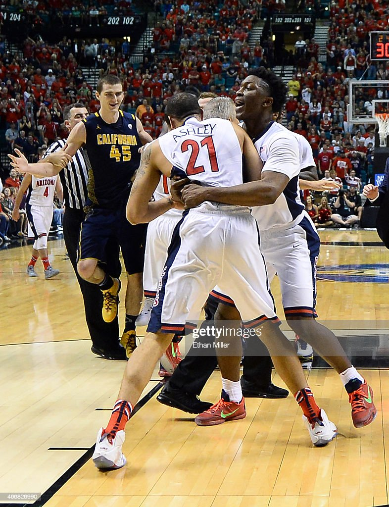 Head coach Sean Miller (R) of the Arizona Wildcats runs onto the court as Stanley Johnson #5 of the Arizona Wildcats holds teammate Brandon Ashley #21 after he and David Kravish #45 (L) of the California Golden Bears got into a scuffle during a quarterfinal game of the Pac-12 Basketball Tournament at the MGM Grand Garden Arena on March 12, 2015 in Las Vegas, Nevada. Arizona won 73-51.
