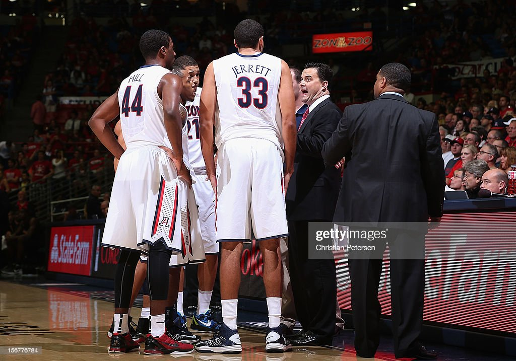 Head coach Sean Miller of the Arizona Wildcats talks to his team in a huddle during the college basketball game against the Long Beach State 49ers at McKale Center on November 19, 2012 in Tucson, Arizona. The Wildcats defeated the 49ers 94-72.