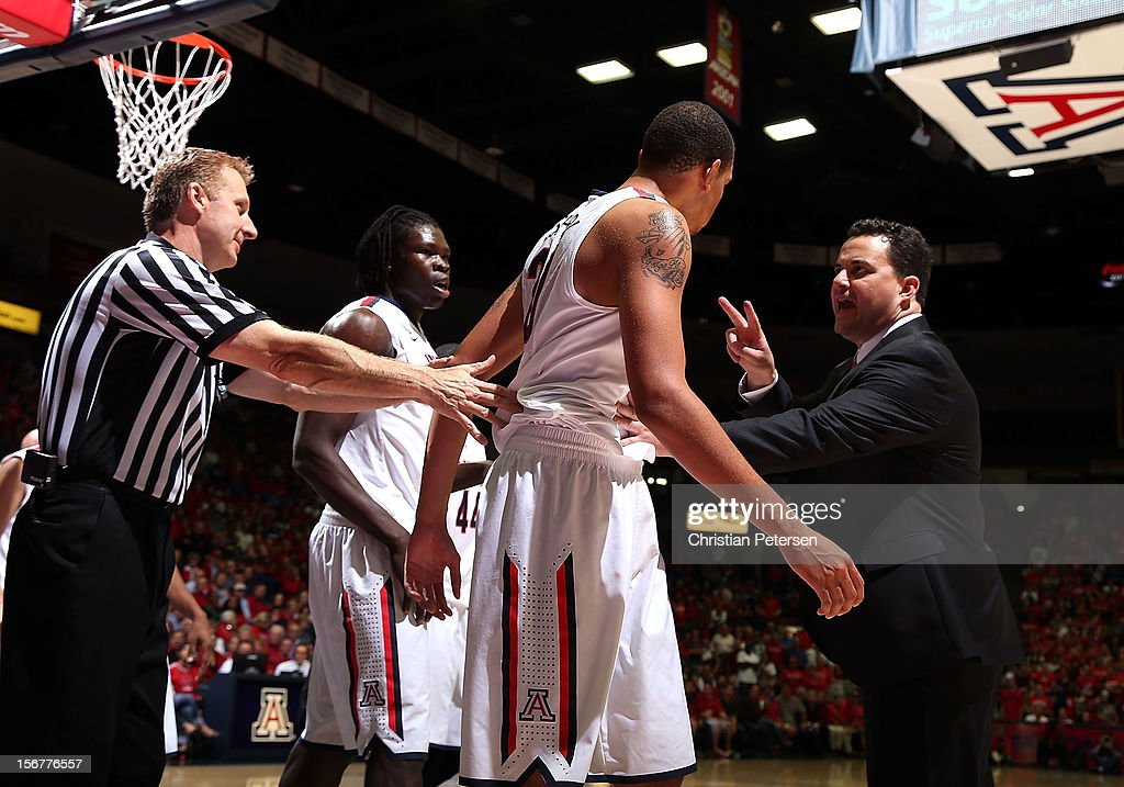 Head coach Sean Miller (R) of the Arizona Wildcats talks with Brandon Ashley #21 during the college basketball game against the Long Beach State 49ers at McKale Center on November 19, 2012 in Tucson, Arizona. The Wildcats defeated the 49ers 94-72.