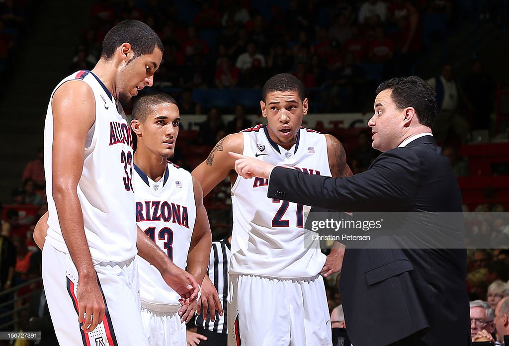 Head coach Sean Miller of the Arizona Wildcats talks with (L-R) Grant Jerrett #33, Nick Johnson #13 and Brandon Ashley #21 during a break from the college basketball game against the Long Beach State 49ers at McKale Center on November 19, 2012 in Tucson, Arizona. The Wildcats defeated the 49ers 94-72.