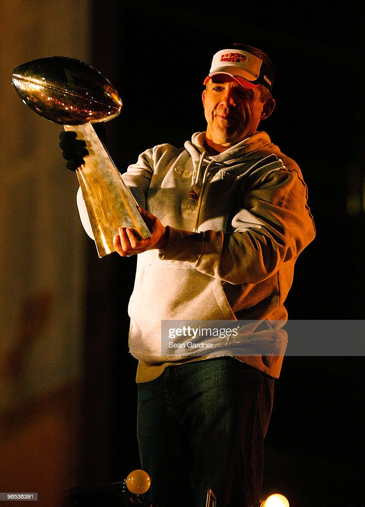 Head coach <a gi-track='captionPersonalityLinkClicked' href=/galleries/search?phrase=Sean+Payton&family=editorial&specificpeople=662200 ng-click='$event.stopPropagation()'>Sean Payton</a> of the New Orleans Saints holds up the Lombardi Trophy as his team parades though the city after winning the Super Bowl XLIV on February 9, 2010 in New Orleans, Louisiana.