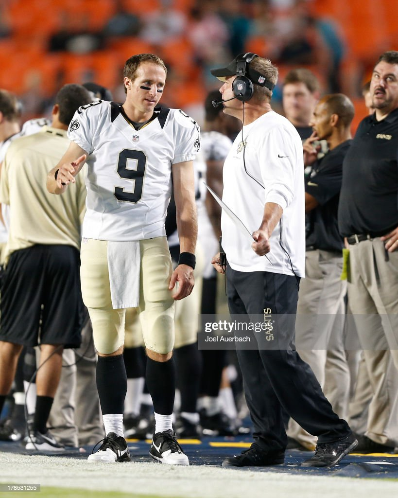 Head coach <a gi-track='captionPersonalityLinkClicked' href=/galleries/search?phrase=Sean+Payton&family=editorial&specificpeople=662200 ng-click='$event.stopPropagation()'>Sean Payton</a> talks to <a gi-track='captionPersonalityLinkClicked' href=/galleries/search?phrase=Drew+Brees&family=editorial&specificpeople=202562 ng-click='$event.stopPropagation()'>Drew Brees</a> #9 of the New Orleans Saints during a break in action against the Miami Dolphins during a preseason game on August 29, 2013 at Sun Life Stadium in Miami Gardens, Florida. The Dolphins defeated the Saints 24-21.