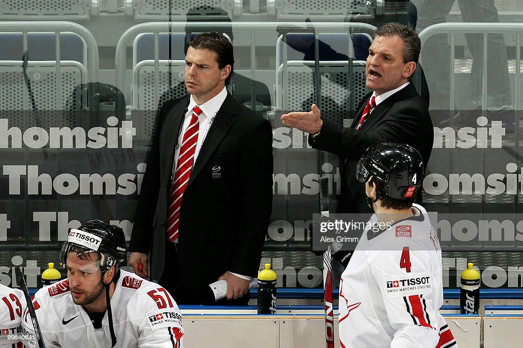 Head coach <a gi-track='captionPersonalityLinkClicked' href=/galleries/search?phrase=Sean+Simpson&family=editorial&specificpeople=4607563 ng-click='$event.stopPropagation()'>Sean Simpson</a> of Switzerland (R) reacts during the IIHF World Championship group F qualification round match between Norway and Switzerland at SAP Arena on May 17, 2010 in Mannheim, Germany.
