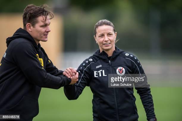 Head Coach Sebastian Geppert and Head Coach Inka Grings shake hands after the B Juniors Bundesliga match between Borussia Dortmund and FC Viktoria...
