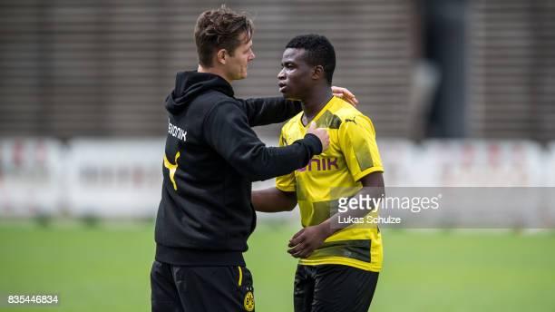 Head Coach Sebastian Geppert hugs Youssoufa Moukoko of Dortmund during the B Juniors Bundesliga match between Borussia Dortmund and FC Viktoria Koeln...