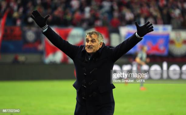 Head coach Senol Guenes of Besiktas Istanbul celebrates during the UEFA Champions League group G match between RB Leipzig and Besiktas at Red Bull...
