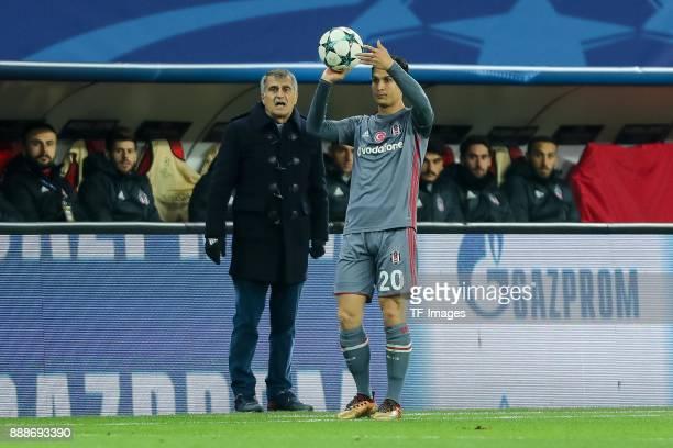 Head coach Senol Guenes of Besiktas looks on Necip Uysal of Besiktas controls the ball during the UEFA Champions League group G soccer match between...