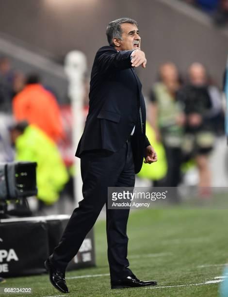 Head coach Senol Gunes of Besiktas reacts during the UEFA Europa League first leg quarter final football match between Olympique Lyonnais and...