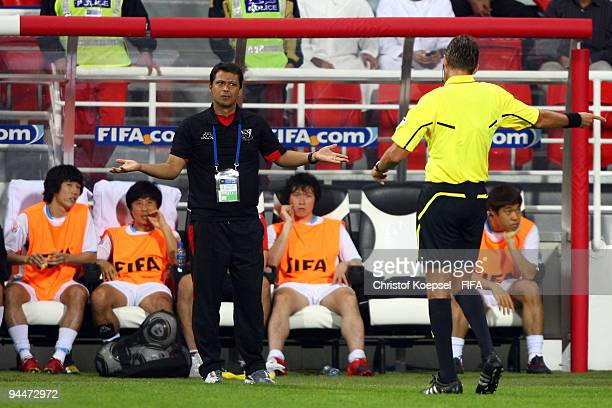 Head coach Sergio Farias of Pohang Steelers looks thoughtful to referee Roberto Rosetti during the FIFA Club World Cup semifinal match between Pohang...
