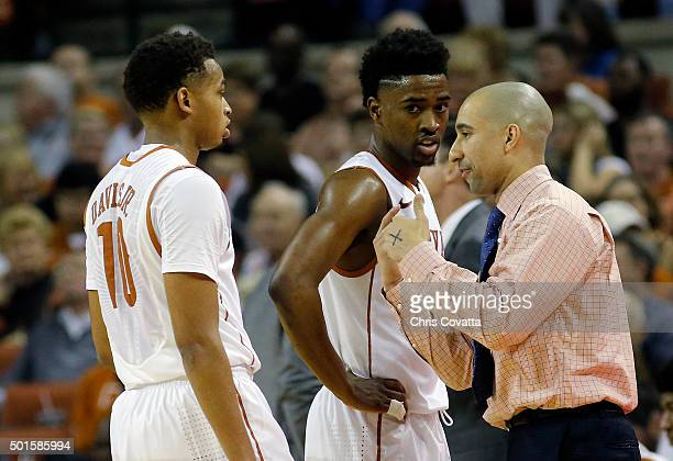 Head coach Shaka Smart of the Texas Longhorns talks with Eric Davis Jr #10 and Isaiah Taylor during the game with the North Carolina Tar Heels at the...